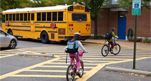 Kids Riding Bikes Near a Bus