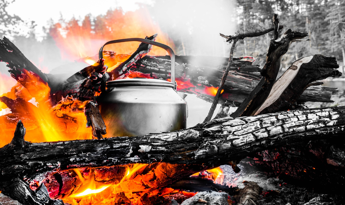 Boiling water on camp fire